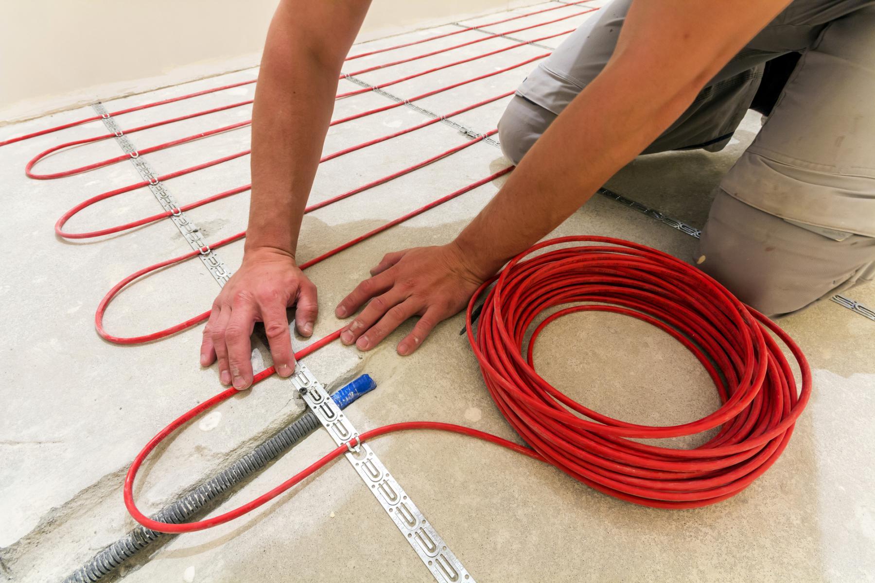 Electrician laying underfloor heating